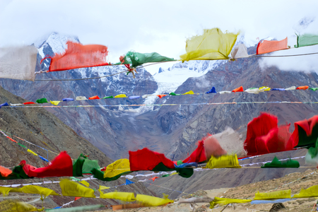 Tibetan flags and hard wind are in mountains. Scare away evil spirits.
