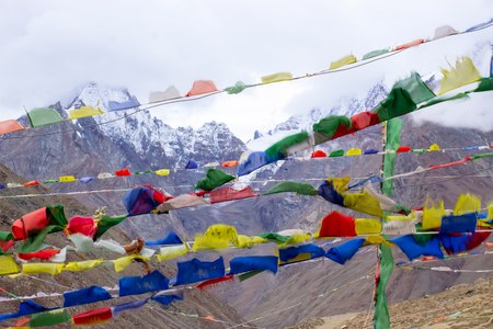 Tibetan flags with snow peaks on background. Scare away evil spirits. Stock fotó