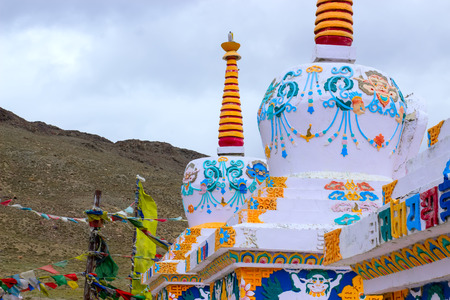 Beautiful Tibetan stupas in the Himalayan mountains. In the background are  tibetan flags. Tourism concept. Stock fotó