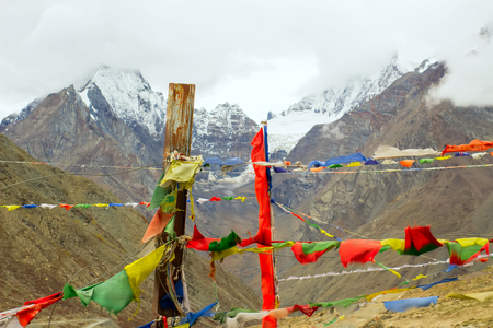 Tibetan flags with mantras develop in the wind in Himalayas. Scare away evil spirits.