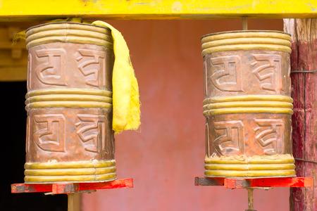 Cylinders with Tibetan symbols in Sanskrit for meditation