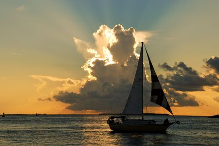 Sailing ship n front of scenic clouds and sunset
