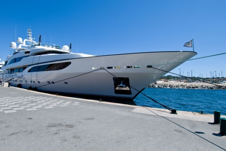 large and shiny yacht anchored at the port Stock Photo