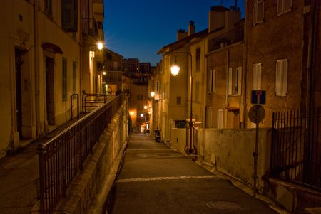 Night shot of an alley with stone walls in Cannes photo