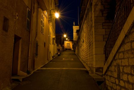 backstreet: Night shot of an alley with stone walls in Cannes