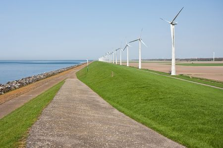 Windmills along the dike in the Netherlands photo
