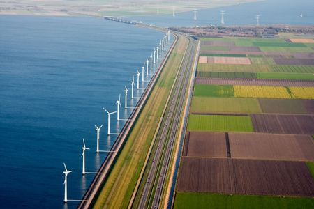 Aerial view of Dutch farmland with  windmills along the dike Stock Photo