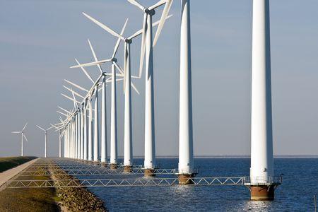 dike: Dutch windmills along the dike Stock Photo
