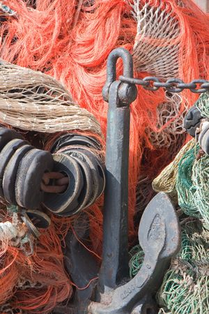 Old anchor and fishing nets photo