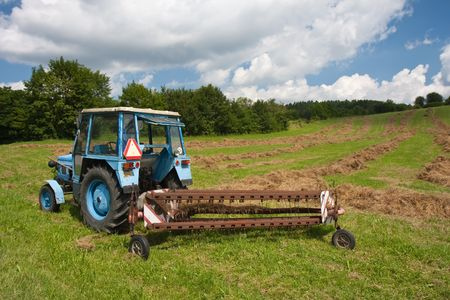 Old tractor with trailer collecting  grass in Czech photo