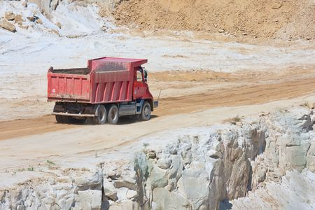 Red truck in an open magnesium mine, Czech republic photo