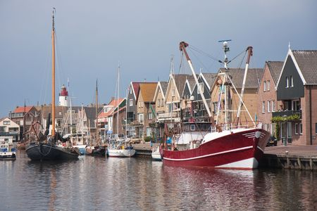 Traditional and modern fishing cutter in the harbor of Urk, the Netherlands photo
