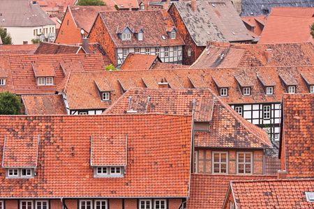 Facing at the red roofs of the medieval city Quedlinburg in Germany photo