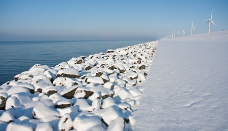 Virgin snow along the endless coast in the netherlands photo