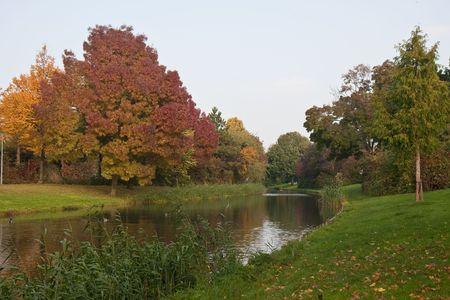 watercourse: Autumn foliage along nice dutch watercourse Stock Photo