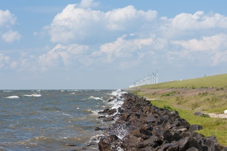Endless dike with windmills  in the Netherlands photo