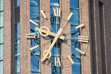 Enormous clock of a big tower in the netherlands photo