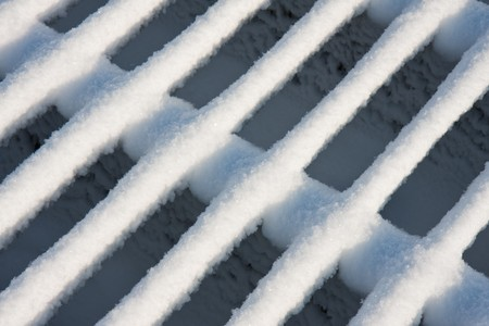 Iron cattle grid covered with fresh new snow Stock Photo - 8048971