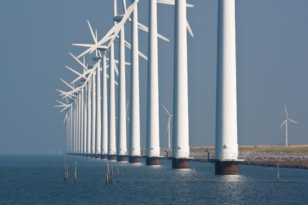 Big windturbines along the Dutch coast photo