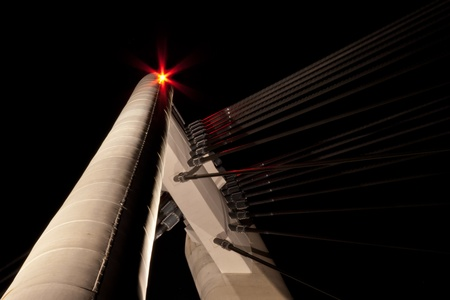 Cable stayed bridge by night in the Netherlands photo