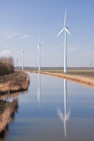 Dutch rural landscape with big windturbines photo