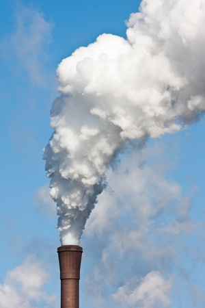 Smokestack with heavy pollution against a blue sky Stock Photo - 9237651