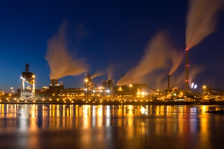Big Dutch steel factory with smokestacks at night Stock Photo - 9237650