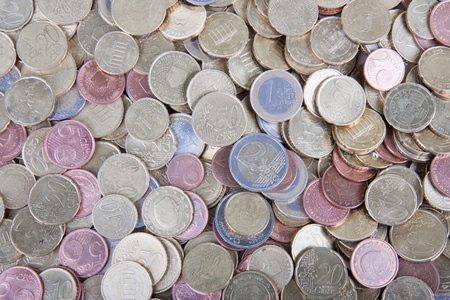 debt collection: Pile of many  european coins