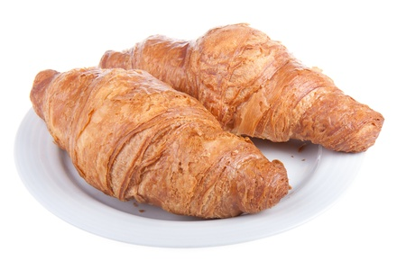 Two delicious croissants on a plate, isolated on white Stock Photo - 9506154