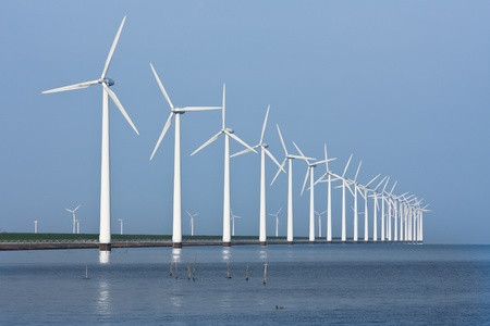 Long row of windmills, mirrored in the Dutch sea Stock Photo