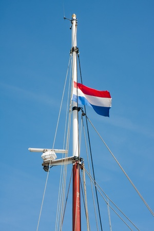 Dutch flag in top of a saling vessel Stock Photo - 9609607