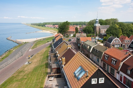 Seafront of a Dutch fishing village seen from the Lighthouse photo