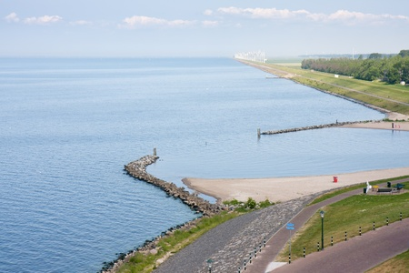 Seafront of a Dutch town with in front a big windfarm photo