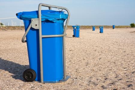 Big blue dust bins at the beach photo