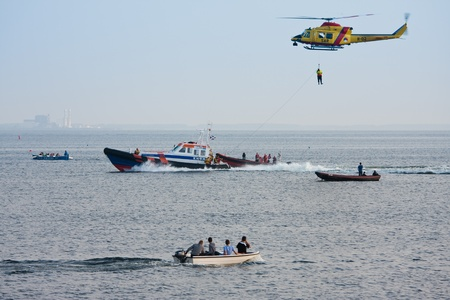 URK, THE NETHERLANDS - JUN 7 2011: The lifeboat of Urk is practicing with a rescue helicopter of the Dutch Royal Airforce in the IJssellake near Urk