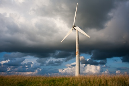 Windturbine with behind it a beautiful Dutch Cloudscape photo