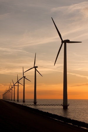 Long row of windturbines in the sea Stock Photo - 9956512