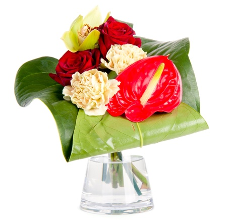 Beautiful bouquet in a vase, isolated on white photo