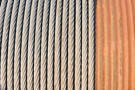 Detail of a big winch winding a steel cable photo