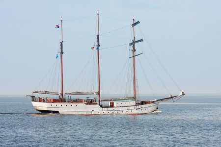 Typical old Dutch three mast clipper  sailing on the sea photo