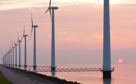 Dutch wind power under sunset along the coast photo