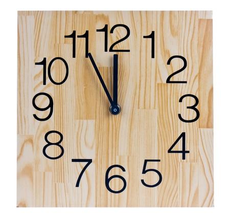 timekeeping: Wooden clock saying five to twelve Stock Photo