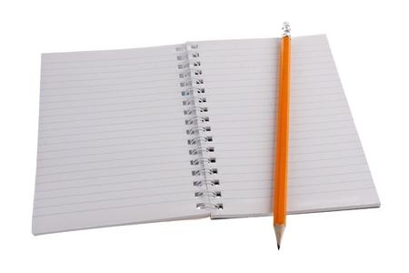 白で隔離は鉛筆でのワーク ・ ブック 写真素材