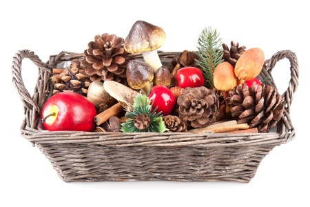 Wooden basket with autumn decoration photo