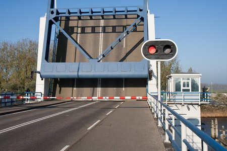 counterweight: Opened bascule bridge in the Netherlands with red stop sign