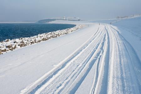 Dutch winter with snowy dike photo