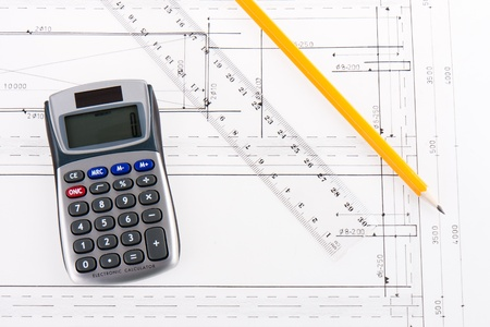 Building plan with calculator, ruler and pencil Stock Photo - 11713614
