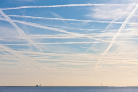 aerodynamic trails from plains above the Dutch sea Stock Photo