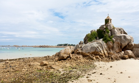 French coast of Brittany with a small chapel at the rocks