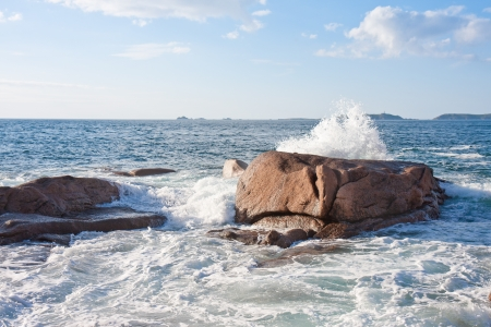 Ocean waves breaking at  the granite coast of France, Brittany photo